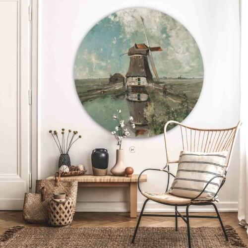 Ronde kunst aan de muur Een molen aan de poldervaart
